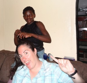 Naomi giving me the salon treatment at Oz Kids Orphanage.
