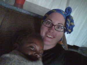 Cuddling with Chipego at Oz Kids Orphanage.